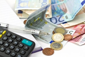 bigstock-Euro-money-counting-with-calcu-26939645