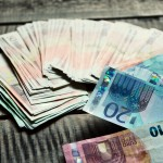 Euro banknotes. Background with european cash money on wooden ba